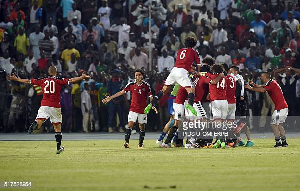 Egypt's players celebrate a goal during the African Cup of Nations qualification match between Egypt and Nigeria in Kaduna on March 25 2016 / AFP /...