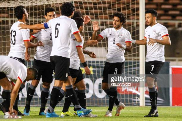 Egypt's players celebrate after scoring during Cameroon 2021 Africa Cup of Nations qualification Group G football match between Kenya and Egypt at...