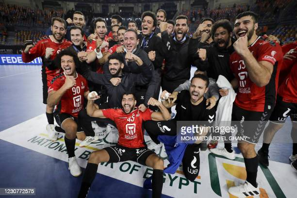 Egypt's players celebrate their win during the 2021 World Men's Handball Championship match between Group IV teams Slovenia and Egypt at the Cairo...