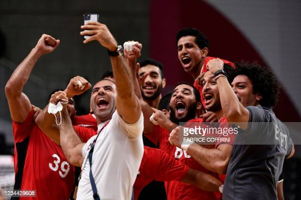 Egypt's players pose for a selfie as they celebrate their victory after the men's quarterfinal handball match between Germany and Egypt of the Tokyo...