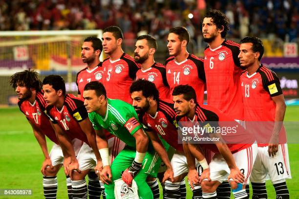 Egypt's players pose for picture before the FIFA World Cup 2018 qualification football match between Egypt and Uganda at the Borg alArab Stadium near...