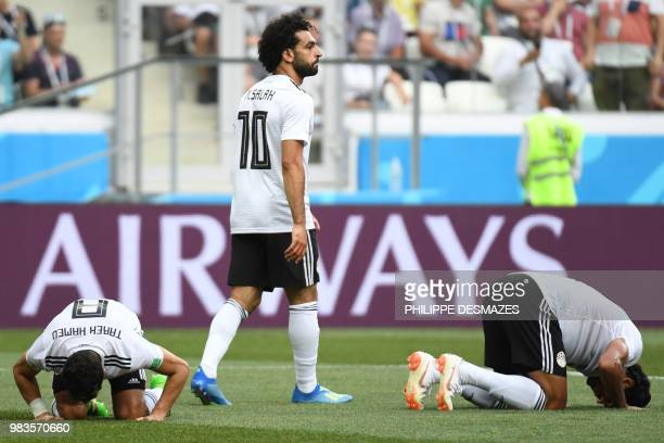 TOPSHOT Egypt's players react as forward Mohamed Salah scored during the Russia 2018 World Cup Group A football match between Saudi Arabia and Egypt...