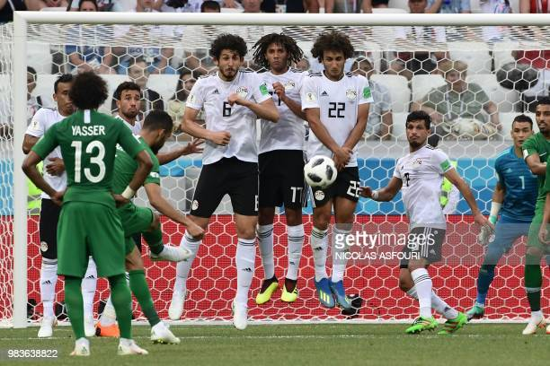 TOPSHOT Egypt's players stop a freekick by Saudi Arabia's defender Mohammed AlBurayk during the Russia 2018 World Cup Group A football match between...