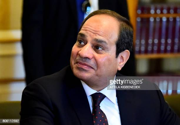 Egypt's President Abdel Fattah AlSisi looks on to Hungarian president Janos Ader during a visit at the presidential palace in Budapest on July 3 2017...