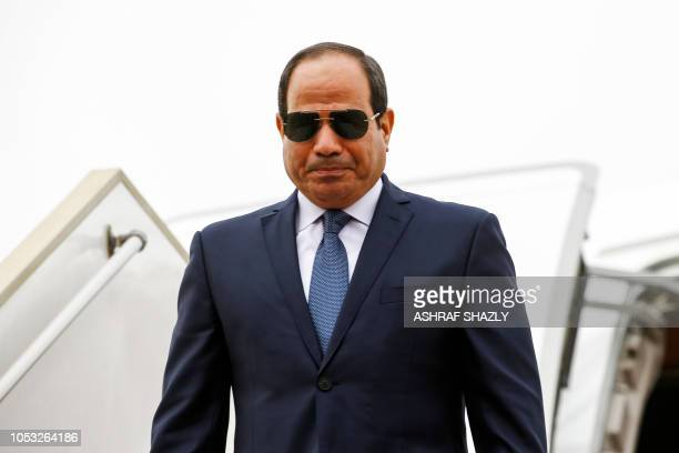 Egypt's President AbdelFattah alSisi disembarks from his plane upon his arrival at Khartoum International Airport outside the Sudanese capital on...