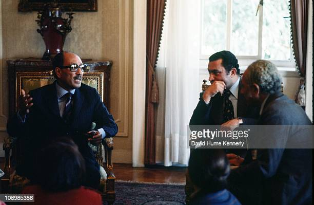 Egypt's President Anwar al Sadat in discussion with his Vice President Hosni Mubarak Cairo December 1977