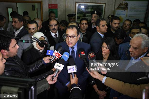 Egypt's Prime Minister Mostafa Madbouli speaks to journalists as he and Health Minister Hala Zayed arrives at the hospital where Vietnamese victims...