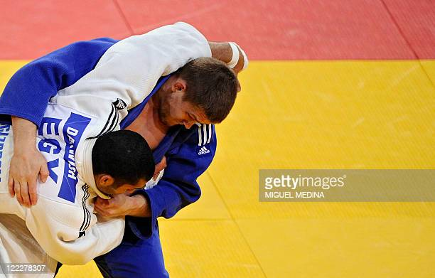 Egypt's Ramadan Darwish fights against Kazakhstan's Maxim Rakov during their semifinal match in the 100kg category at the Judo World Championships on...