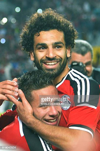 Egypt's Ramadan Sobhi celebrate his goal against Nigeria with his teammate Mohamed Salah during their African Cup of Nations group G qualification...