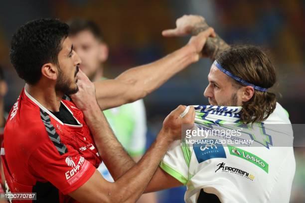 Egypt's right back Yahia Khaled Mahmoud and Slovenia's centre back Dean Bombac argue during the 2021 World Men's Handball Championship match between...