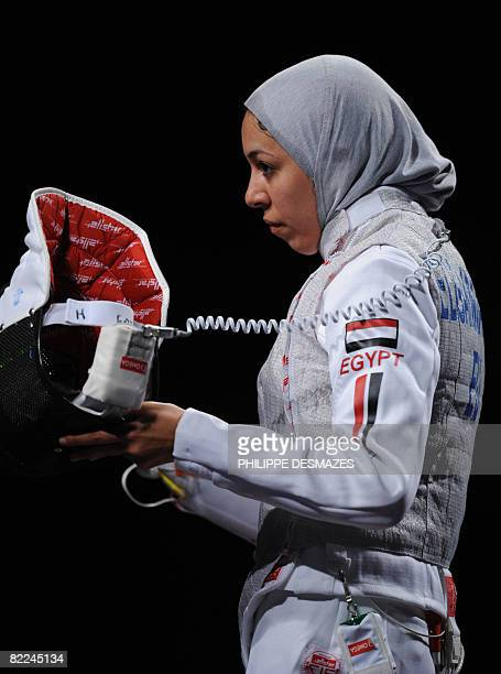 Egypt's Shaimaa elGammal looks dejected after losing the Women's individual Foil elimination round of 64 match to fellow countrywoman Iman Shaban on...