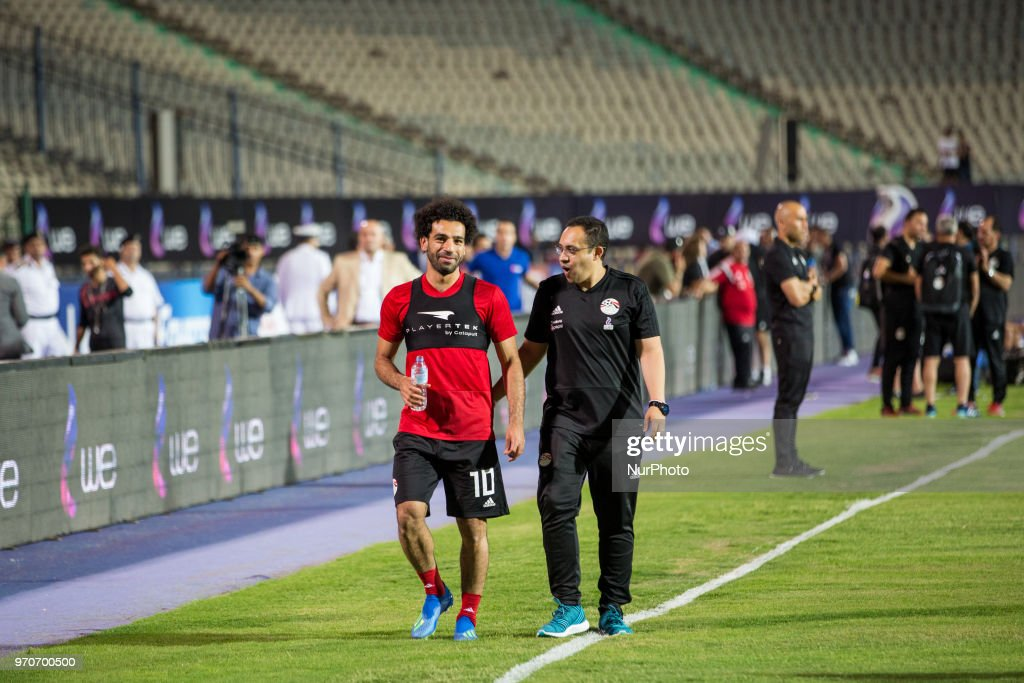 Egypt's soccer star Mohamed Salah (L) walks with Egypt's National Team doctor Mohamed Abou El-Ela during a training session for the team in preparation for the 2018 World Cup in Russia, at Cairo Stadium, in Cairo, Egypt, 09 June 2018.