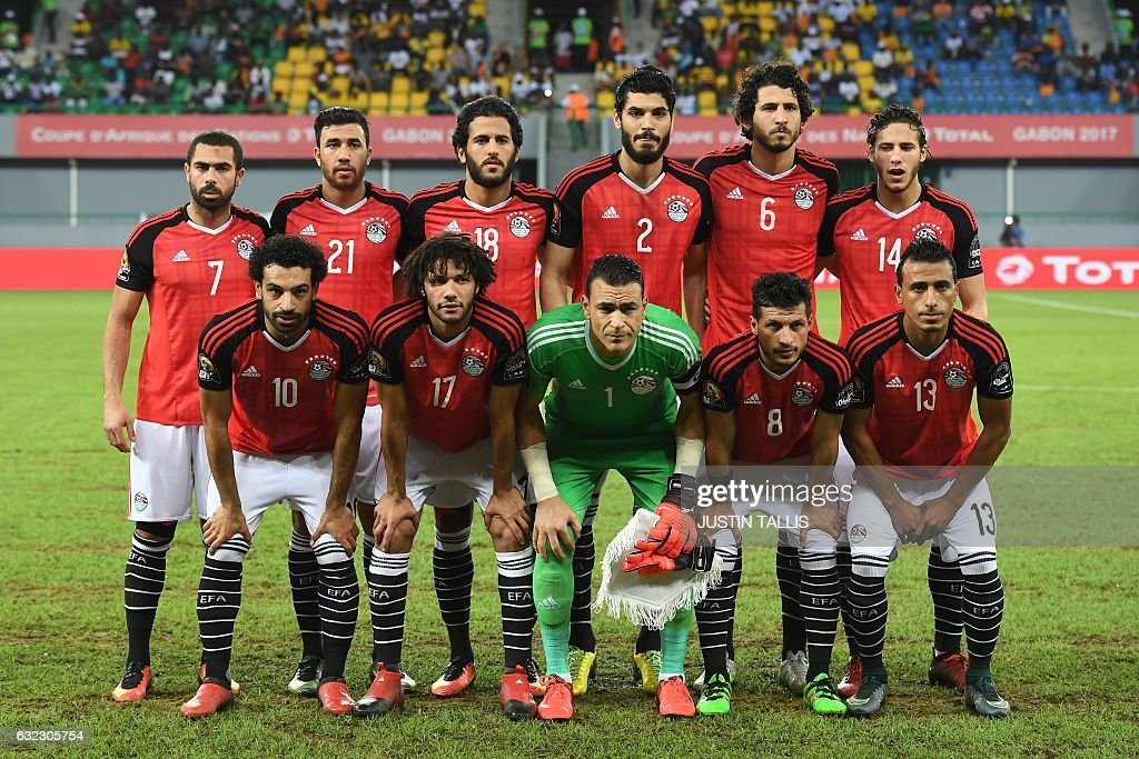 Egypt's squad (back L-R) defender Ahmed Fathi, midfielder Mahmoud Hassan, forward Marwan Mohsen, defender Ali Gabr, defender Ahmed Hegazy, midfielder Ramadan Sobhi, (L-R) forward Mohamed Salah, midfielder Mohamed Elneny, goalkeeper Essam El-Hadary, midfielder Tarek Hamed and defender Mohamed Abdel-Shafy pose for a group picture ahead of the 2017 Africa Cup of Nations group D football match between Egypt and Uganda in Port-Gentil on January 21, 2017. / AFP / Justin TALLIS
