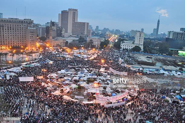 egypt's tahrir square - february 9, 2011 - tahrir square cairo stock pictures, royalty-free photos & images