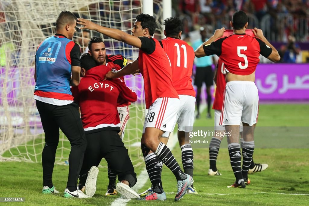 Egypt's team players celebrate wining against Congo's team during their World Cup 2018 Africa qualifying match between Egypt and Congo at the Borg el-Arab stadium in Alexandria on October 8, 2017. Liverpool striker Mohamed Salah converted a stoppage-time penalty to give Egypt a dramatic 2-1 win over Congo Brazzaville Sunday and a place at the 2018 World Cup in Russia.