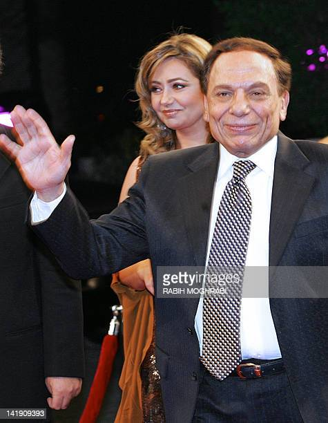 Egypt's top comedian Adel Imam waves upon his arrival followed by film star Leila Elwi at the opening ceremony of Dubai's International Film Festival...