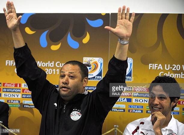 Egypt's U20 football team coach El Sayed Diaa gestures next to his player Mohamed Ibrahima during a press conference in Medellin Antioquia department...
