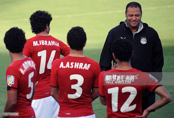 Egypt's U20 football team coach El Sayed Diaa speaks with his players during a training session at Atanasio Girardot stadium in Medellin Antioquia...