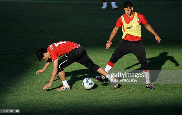 Egypt's U20 player Ahmed Tawfic vies for the ball with Ahmed Nabil during a training session at Atanasio Girardot stadium in Medellin Antioquia...