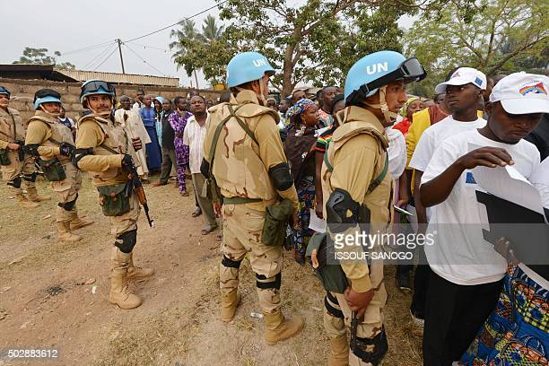 Egypt's UN peacekeepers take position ouside the polling station in Bangui on December 30 2015 in the Muslim district in PK5 of the capital as people...