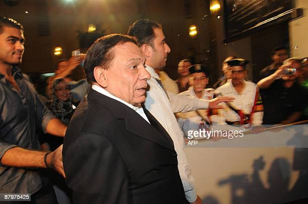 Egypt's veteran comedian Adel Imam arrives at Cairo's Opera House late on May 25 2009 to attend the premiere of the new movie Ibrahim Labyad about...
