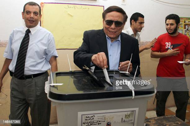 Egypt's veteran comedian Adel Imam casts his vote at a polling station in Cairo on June 17 on the last day of a highly divisive presidential runoff...