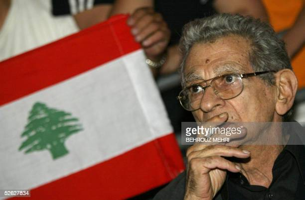 Egypt's veteran film director Youssef Chahine attends the concert of Lebanese singer Magida alRoumi in downtown Beirut's landmark Martyrs Square late...