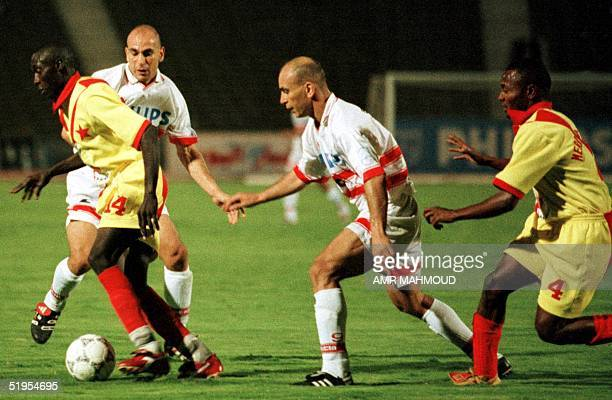 Egypt's Zamalek club players Hossam Hassan and Ibrahim Hassan challenge Sudan's alMalikh club players Golenh and Aldawo late 27 August 2000 in Cairo...