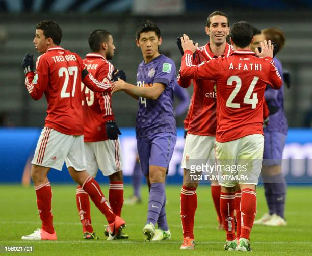 Egypy's AlAhly forward Mohamed Aboutrika celebrates his team's victory over Japan's San Frecce Hiroshima with midfielder Ahmed Fathi after their 2012...