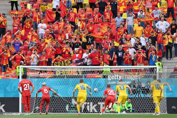 Egzijan Alioski of North Macedonia has a penalty saved by Georgiy Bushchan of Ukraine before scoring their side's first goal during the UEFA Euro...