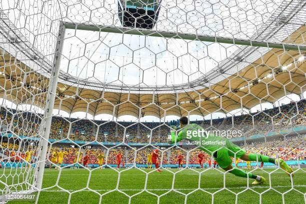 Egzijan Alioski of North Macedonia has a penalty saved by Georgiy Bushchan of Ukraine before scoring their side's first goal from the rebound during...
