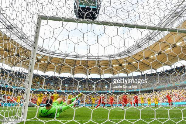 Egzijan Alioski of North Macedonia scores their side's first goal after having a penalty saved by Georgiy Bushchan of Ukraine during the UEFA Euro...