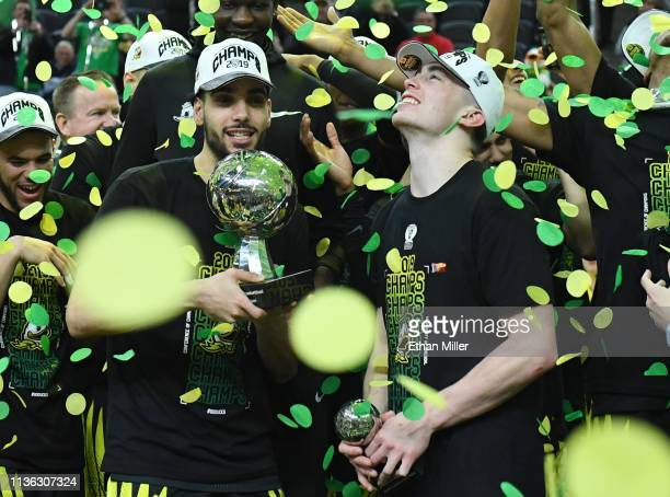Ehab Amin and Payton Pritchard of the Oregon Ducks celebrate after the team's 6848 victory over the Washington Huskies to win the championship game...