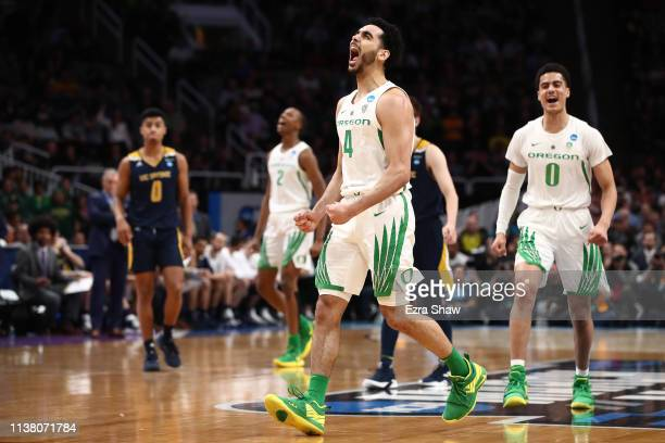 Ehab Amin of the Oregon Ducks celebrates with Will Richardson after a play in the second half against the UC Irvine Anteaters during the second round...