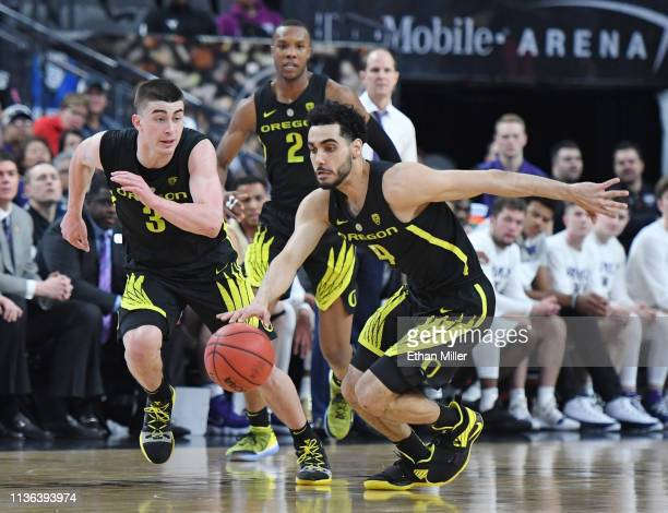 Ehab Amin of the Oregon Ducks starts a fast break ahead of teammates Payton Pritchard and Louis King against the Washington Huskies during the...