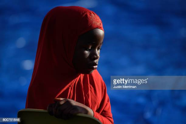Eheze Hassani of Sharpsburg Pennsylvania waits for the prayer to begin during an Eid alFitr celebration which marks the end of Ramadan on June 25...