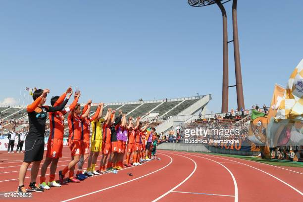 Ehime FC players applaud supporters after their 20 victory after the JLeague J2 match between Ehime FC and Montedio Yamagata at Nigineer Stadium on...