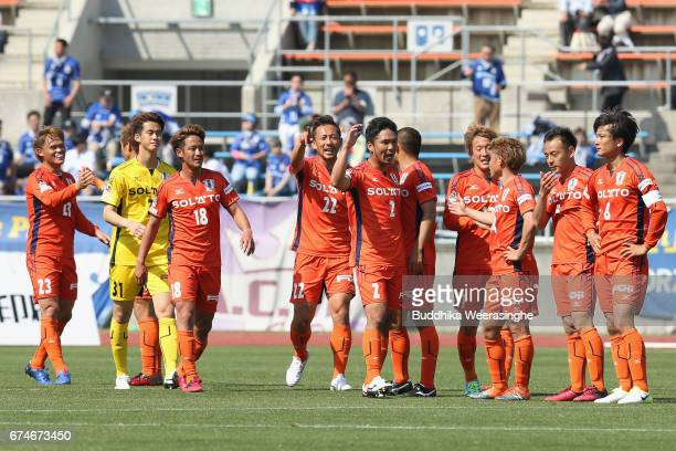 Ehime FC players celebrate their 20 victory after the JLeague J2 match between Ehime FC and Montedio Yamagata at Nigineer Stadium on April 29 2017 in...