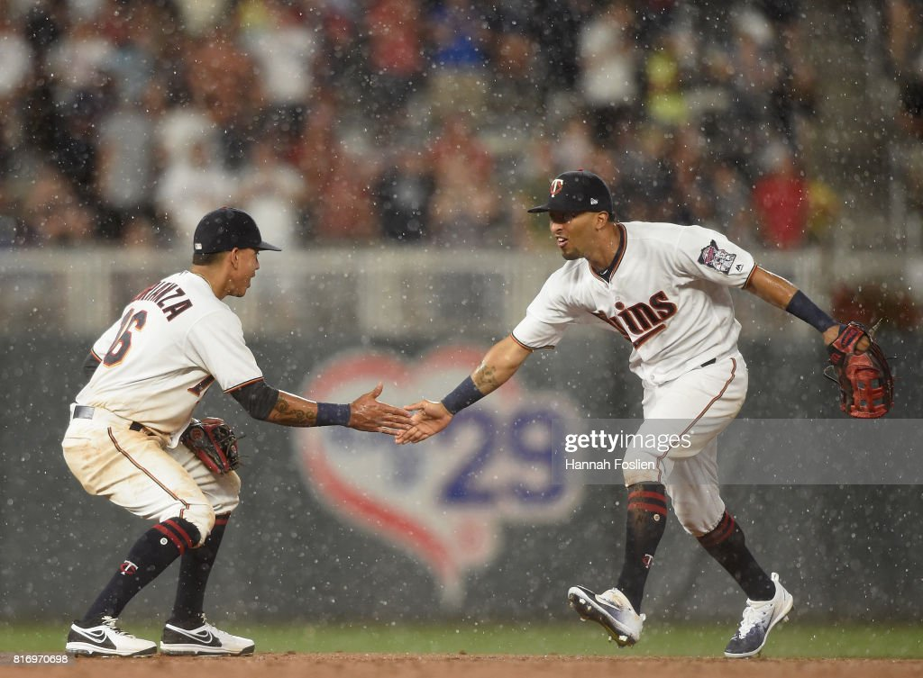 Ehire Adrianza #16 and Eddie Rosario #20 of the Minnesota Twins celebrate winning the game against the New York Yankees on July 17, 2017 at Target Field in Minneapolis, Minnesota. The Twins defeated the Yankees 4-2.