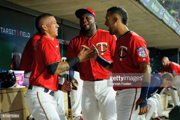 Ehire Adrianza Miguel Sano and Eddie Rosario of the Minnesota Twins speak in the dugout during the game against the Detroit Tigers on September 29...