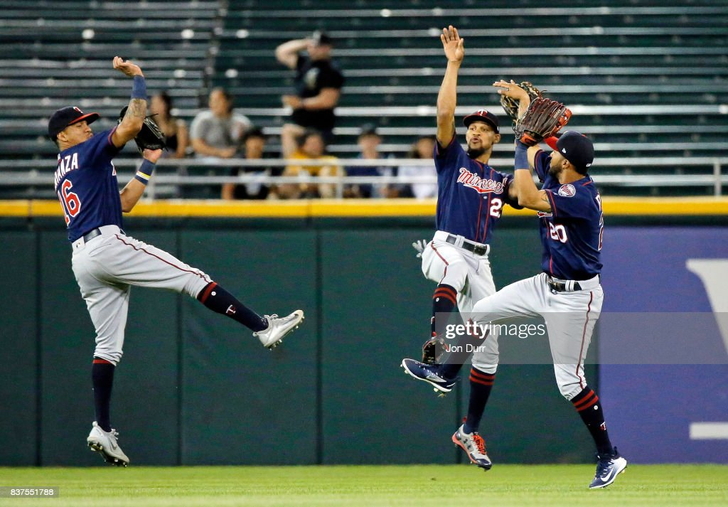 Ehire Adrianza #16 of the Minnesota Twins, Byron Buxton #25 (C) and Eddie Rosario #20 celebrate their win over the Chicago White Sox at Guaranteed Rate Field on August 22, 2017 in Chicago, Illinois. The Minnesota Twins won 4-1.