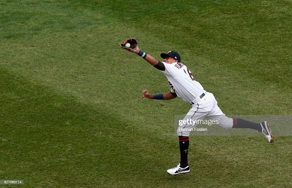 Ehire Adrianza #16 of the Minnesota Twins catches the ball hit by Adrian Beltre #29 of the Texas Rangers during the seventh inning of the game on August 6, 2017 at Target Field in Minneapolis, Minnesota. The Twins defeated the Rangers 6-5.