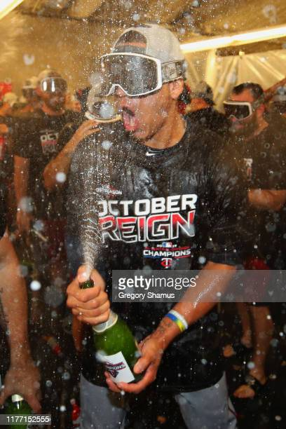 Ehire Adrianza of the Minnesota Twins celebrates winning the American League Central Division title after a 51 win against the Detroit Tigers and a...