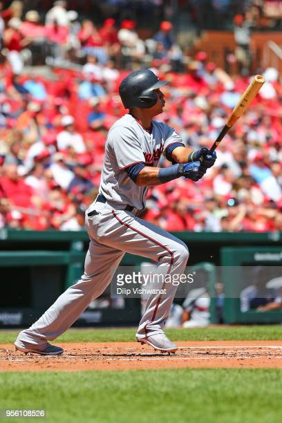 Ehire Adrianza of the Minnesota Twins drives in a sacrifice RBI against the St Louis Cardinals in the second inning at Busch Stadium on May 8 2018 in...