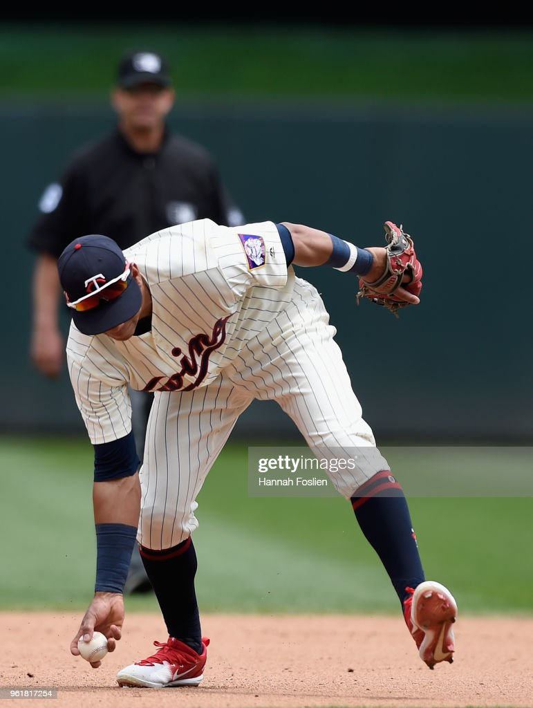 Ehire Adrianza #16 of the Minnesota Twins makes a barehanded play at shortstop on the ball hit by JaCoby Jones #21 of the Detroit Tigers during the fourth inning of the game on May 23, 2018 at Target Field in Minneapolis, Minnesota. Jones was out at first base on the play. The Tigers defeated the Twins 4-1.