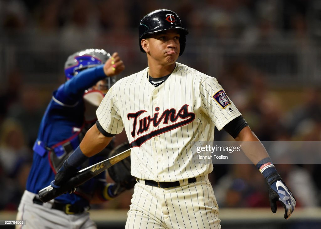 Ehire Adrianza #16 of the Minnesota Twins reacts to striking out against the Texas Rangers during the eighth inning of the game on August 5, 2017 at Target Field in Minneapolis, Minnesota. The Rangers defeated the Twins 4-1.