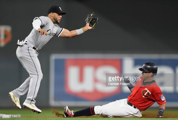 Ehire Adrianza of the Minnesota Twins steals second base against Yoan Moncada of the Chicago White Sox during the second inning in game two of a...