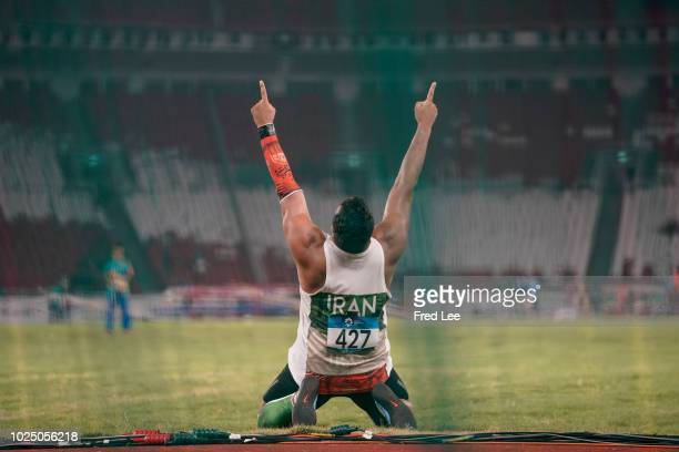 Ehsan Hadadi of Iran celebrates winning in the final of the men's discus throw athletics event during the 2018 Asian Games in Jakarta on August 29,...