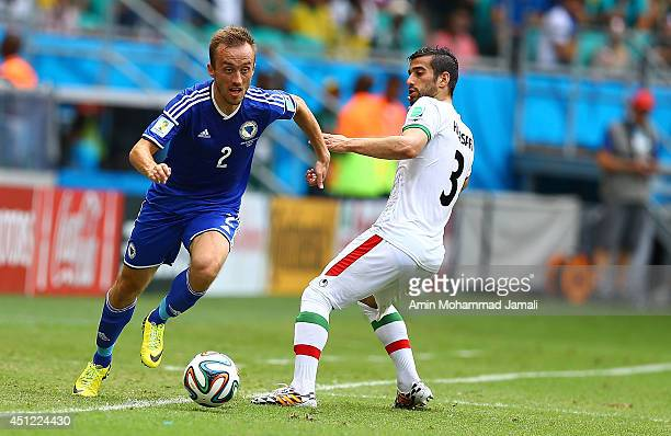 Ehsan Haj Safi of Iran in action against Avdija Vrsajevico of bosnia during the 2014 FIFA World Cup Brazil Group F match between Bosnia and...