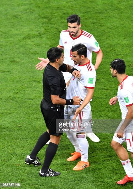 Ehsan Haji Safi of Iran arfiues with Referee Enrique Caceres during the 2018 FIFA World Cup Russia group B match between Iran and Portugal at...